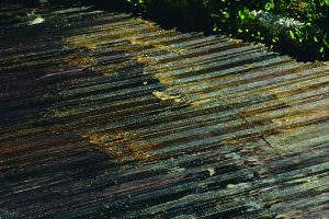 Stripping paint and opaque finishes from decking
