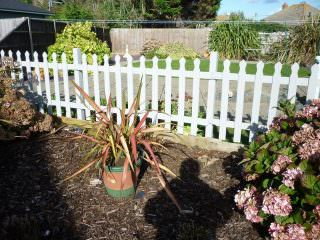 Picket Fence After Application of Bedec Barn Paint